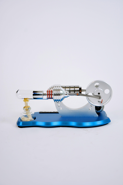 Двигатель Стирлинга на бирюзовой подставке в Москве